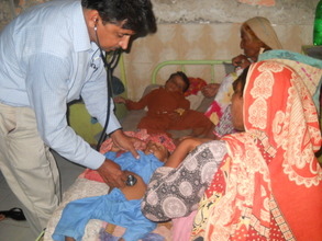 Physician attending to children at Civil Hospital
