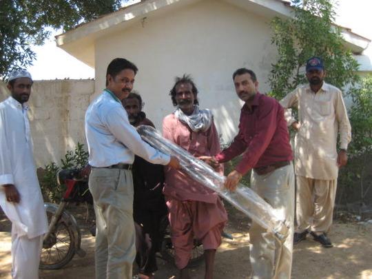 Qamar receiving crutches from the SHINE Team