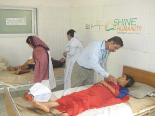 Staff providing care to Shams and Najma
