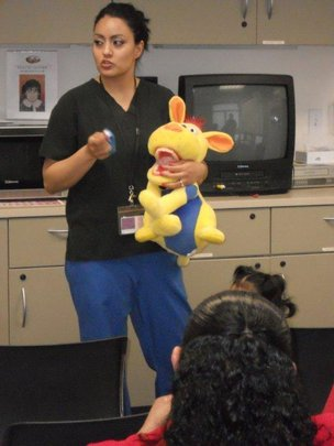 Dental staff and teaching puppet