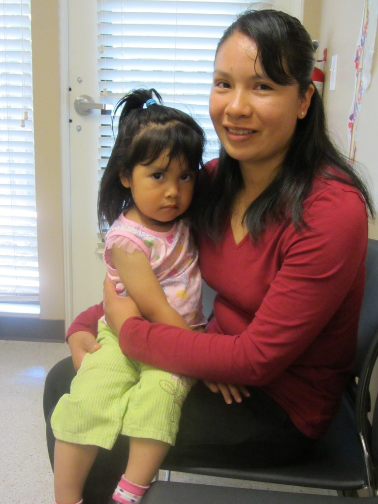 Gabriela smiles with her daughter
