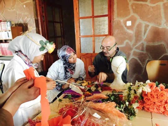 Dar Taliba girls learning from Florist Said Taj.