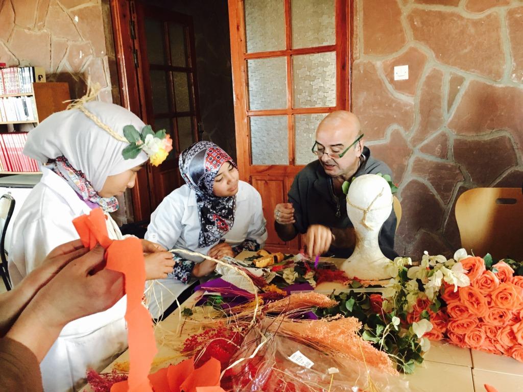 Dar Taliba girls learning from Florist Said Taj.