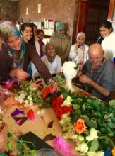 Dar Taliba girls having fun making floral wreaths.
