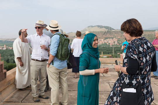 Jamila interacting with visitors to Dar Taliba