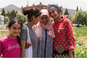 Saida shares a moment with three young gardeners