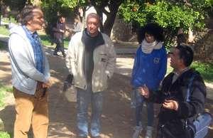 A teacher (far right) provides update on progress