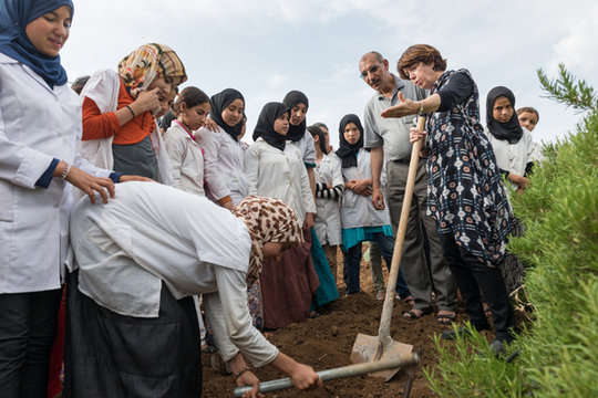 Planting a tree in the new garden at Dar Taliba