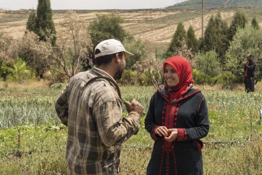 Jamila speaks animatedly with Abdelmalek.
