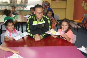 Volunteer Ramsis is proud of his kids' projects
