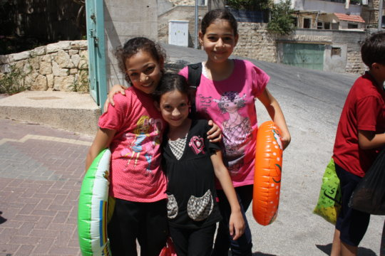 Friends head to the pool during summer camp