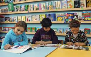 Mariam, Abdul Aziz & Shahd read in the TYO library