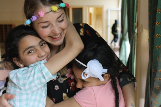 Elisa's students shower her with hugs
