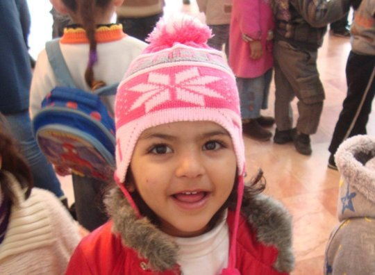 A Core Program participant grins in fuzzy new hat