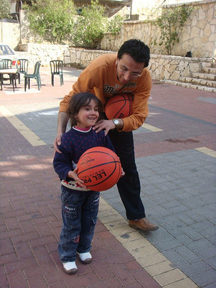 "Volunteer teaches how to ""shoot hoops""!"