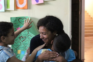 Intern Darializa hugs one of her students goodbye