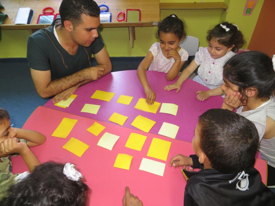 A volunteer helps encourage teamwork