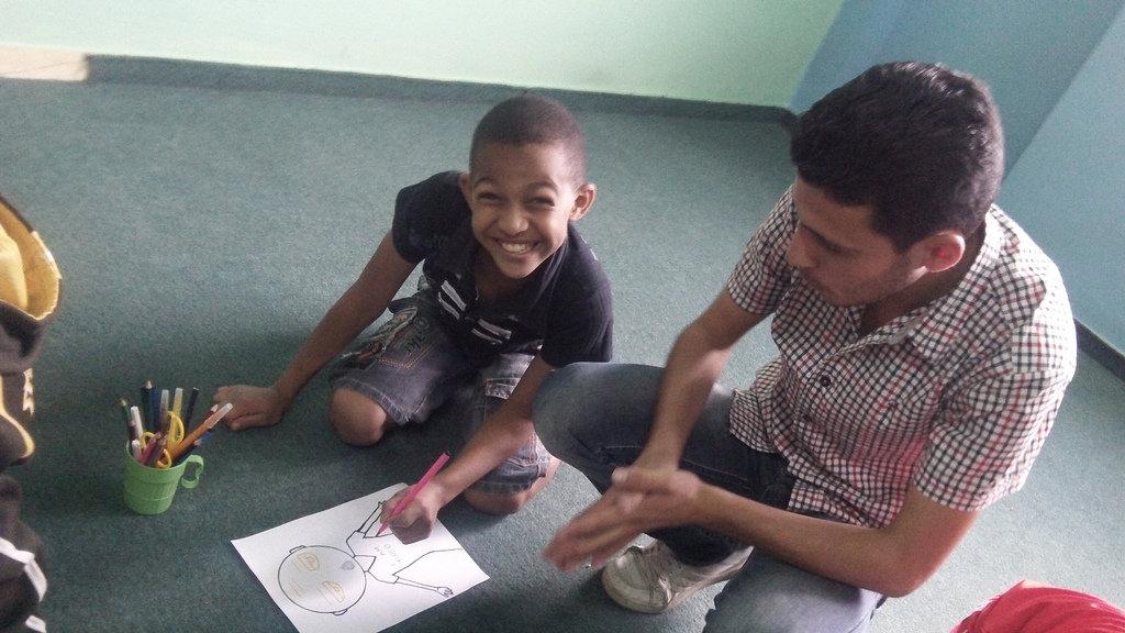 Rafat draws an emotion portrait in drama class