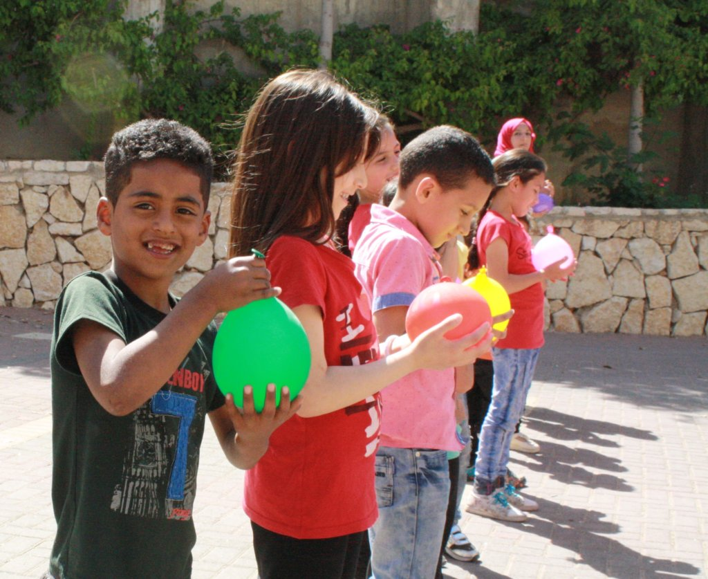 TYO student Yoseph holds his water balloon.