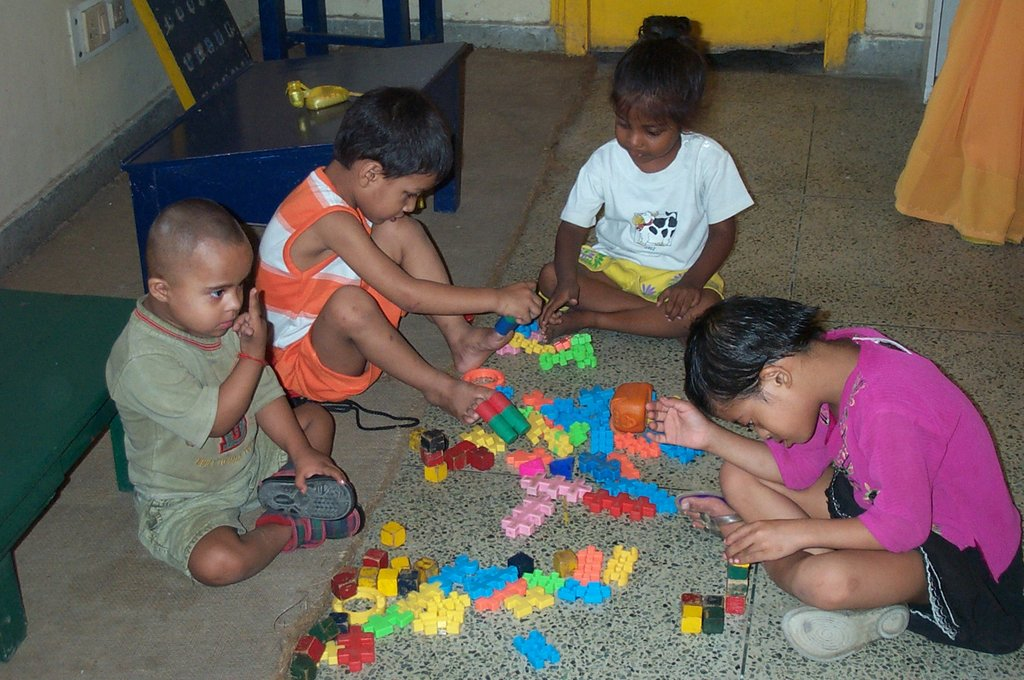A little girl helps her intellectually disabled