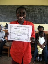 Delphine with her graduation certificate