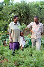 Our agricultural agent Samuel, with a family
