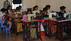 Women Learning to Sew in the SCC Training Room