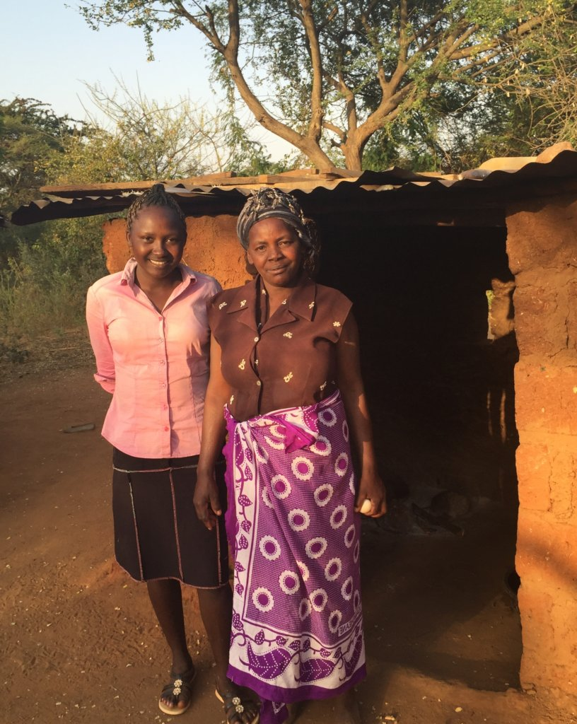 Nancy and her mother outside their home