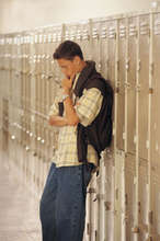 Boy leaning against lockers