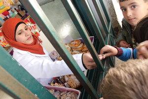 School children buy nutritious snacks at canteen