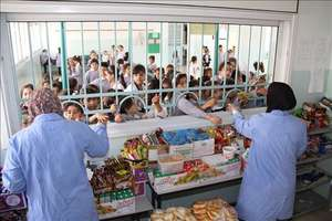 A women-owned school canteen supported by NEF