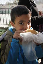 A child enjoys a nutritious snack at school