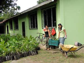 Irma and Charlyn Acosta Elizondo, hauling trees