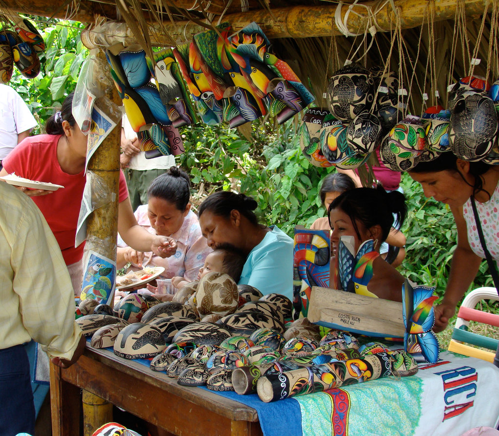 At the annual Maleku festival the beautiful hand-painted and colorful art is offered for purchase by indigenous artisans. Many of the people in this photo participated in the community nurseries for the Rio Sol Bio Corridor. This photo was featured in the LRFF 2012 Calendar in March.