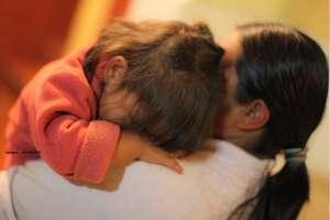 Baby being nurtured at Casa Jackson