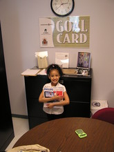 Student proudly holding a redeemed gift