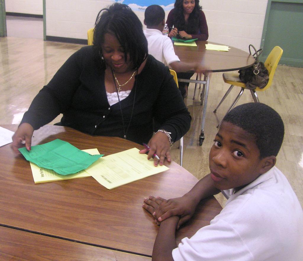 Volunteer helps student with academic scorecard