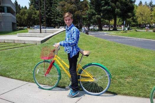 Alex with his colourful Google bike