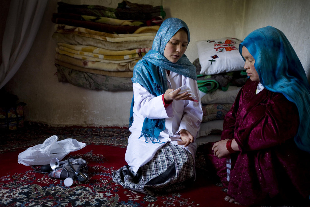 Community midwife, Sadiqa Hossieni dicusses prenatal care with a pregnant woman at her home in the village of Foladi, near  Bamyan, Afghanistan on the 9th June, 2010.