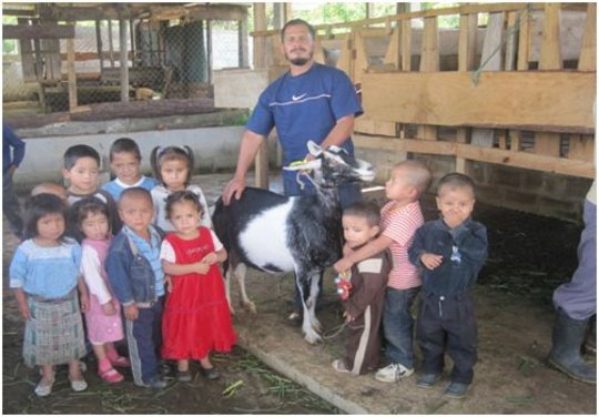 Children with Elmer and one of the goats