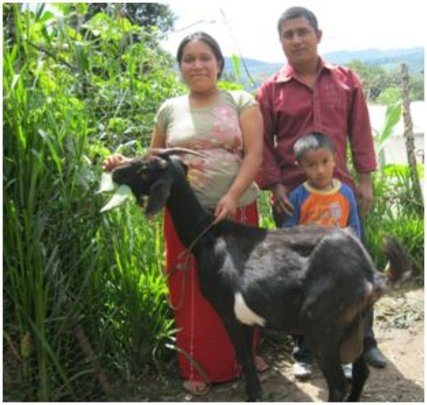 The Brito family and their goat.
