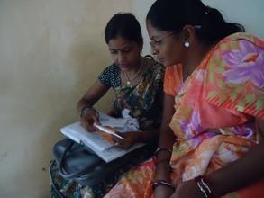 Sundari reviewing protocols with clinic staff