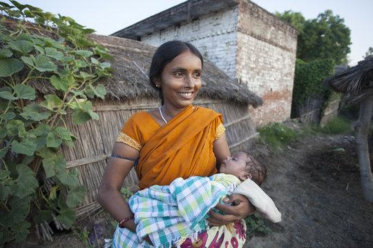 Kiran holding her son in their Raebareli village
