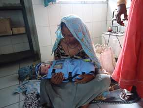 Mother with her baby in Raebareli clinic