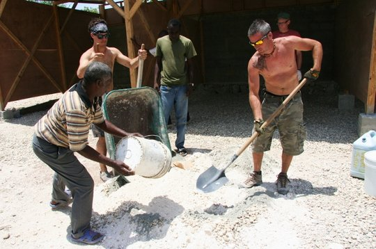 Even school directors help with construction