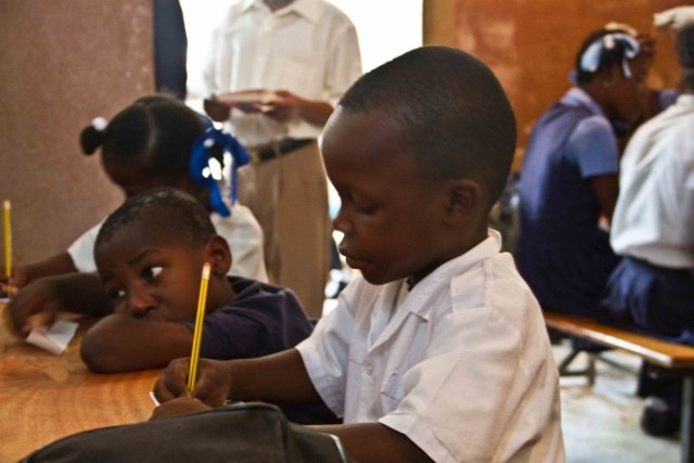 A happy child in school, thanks to you!