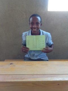 Proud of his passing grade!