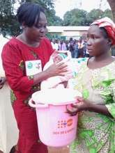 Dekoisse and her new baby receive a dignity kit