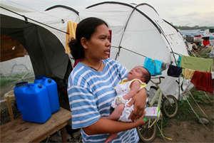 Miraflor Cainoy holding her baby.