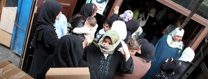 Syrian refugees receiving supplies in Lebanon